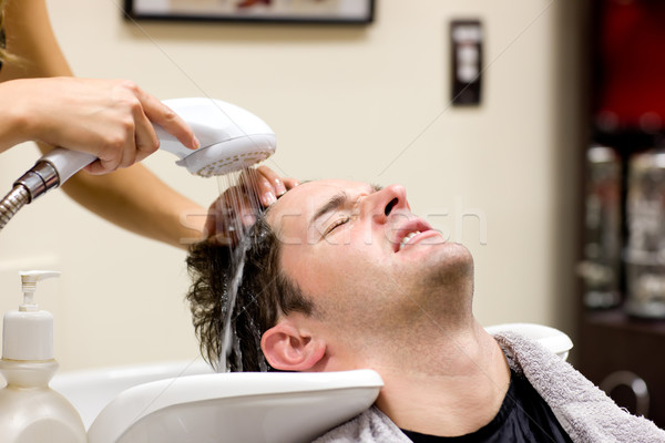 Cute man having his hair washed in a hairdressing salon Stock photo © wavebreak_media