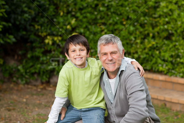 Grandfather with his grandson looking at the camera in the garden  Stock photo © wavebreak_media