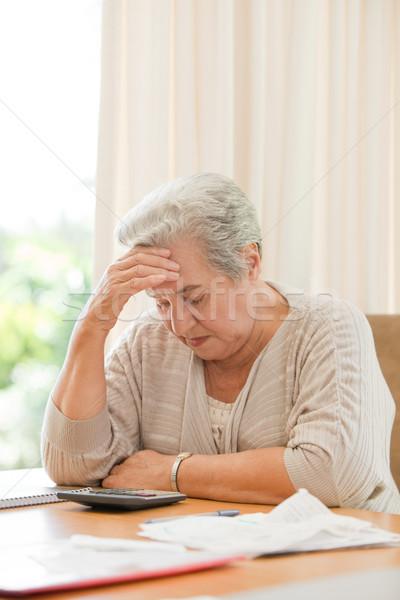Nyugdíjas nő házi számlák arc munka Stock fotó © wavebreak_media