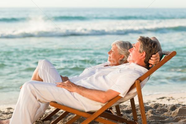 Yaşlı çift rahatlatıcı güverte sandalye kadın Stok fotoğraf © wavebreak_media