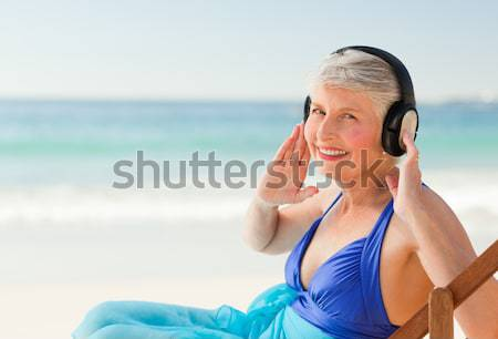Radiant woman listening to some music Stock photo © wavebreak_media