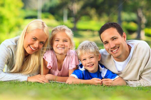 Family lying down in the park Stock photo © wavebreak_media