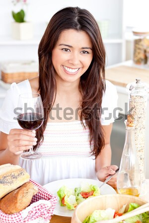 Smiling Woman pouring redwine in a glass in a kitchen Stock photo © wavebreak_media