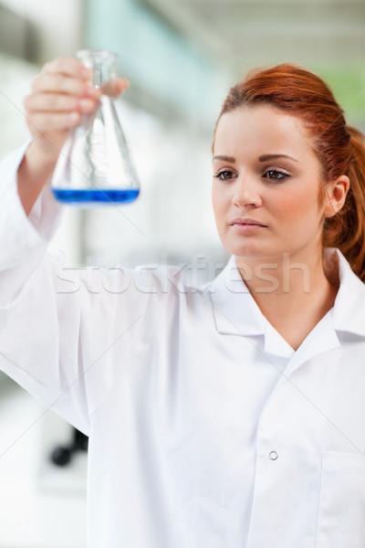 Portret nauki student patrząc niebieski płynnych Zdjęcia stock © wavebreak_media
