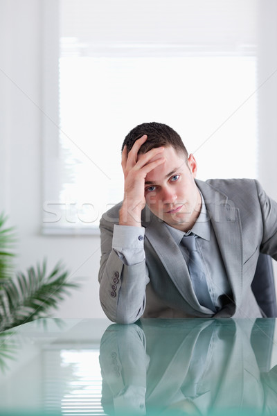 Close up of disappointed businessman sitting behind a table Stock photo © wavebreak_media