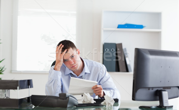 Young businessman worried about invoice Stock photo © wavebreak_media