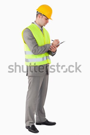 Portrait of a young contractor taking notes against a white background Stock photo © wavebreak_media