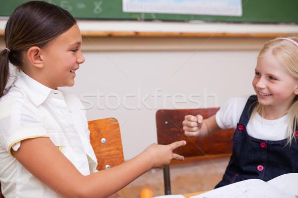 улыбаясь школьницы играет классе бумаги стороны Сток-фото © wavebreak_media