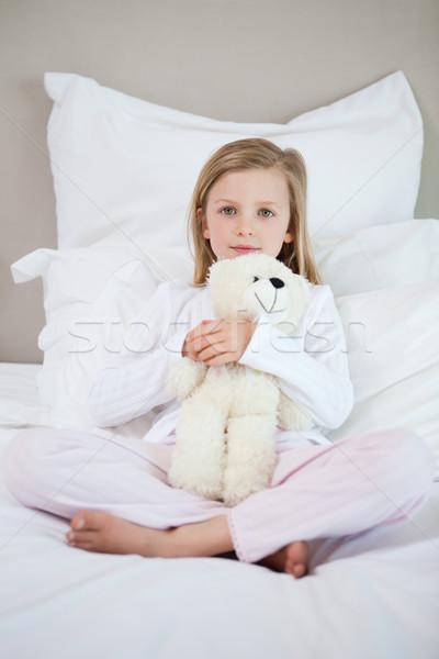 Little girl hugging her teddy on the bed Stock photo © wavebreak_media