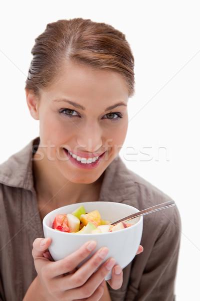 Mosolygó nő tál gyümölcssaláta fehér étel mosoly Stock fotó © wavebreak_media