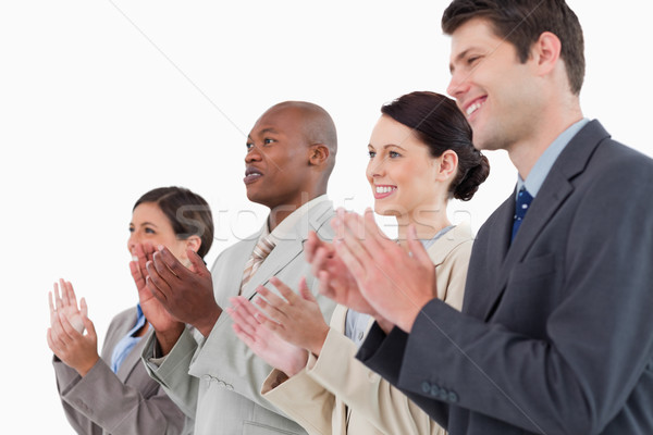 Side view of applauding businessteam standing together against a white background Stock photo © wavebreak_media