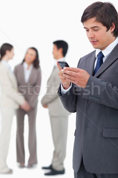 Vendeur lecture équipe derrière Photo stock © wavebreak_media