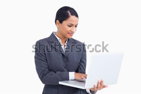 Közelkép elarusítónő laptopot használ fehér számítógép internet Stock fotó © wavebreak_media