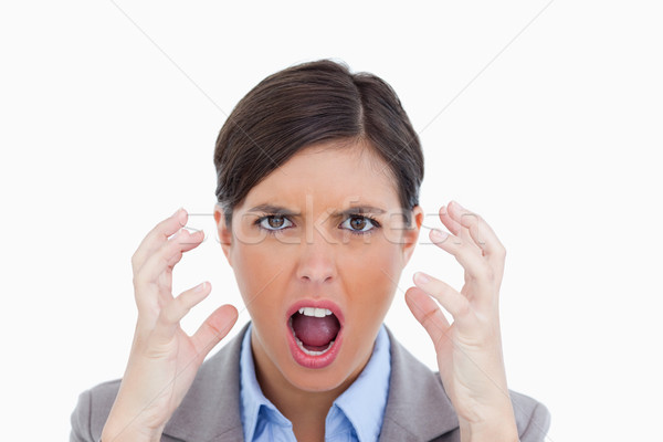 Close up of angry yelling entrepreneur against a white background Stock photo © wavebreak_media
