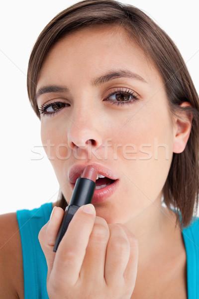 Anziehend vorsichtig Lippenstift weiß Stock foto © wavebreak_media