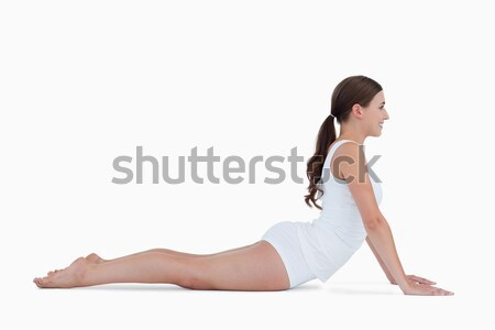 Young brunette practicing gymnastics against a white background Stock photo © wavebreak_media