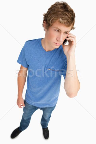 Halszem kilátás fiatalember okostelefon fehér Stock fotó © wavebreak_media