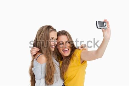 Deux élèves photos blanche souriant Photo stock © wavebreak_media