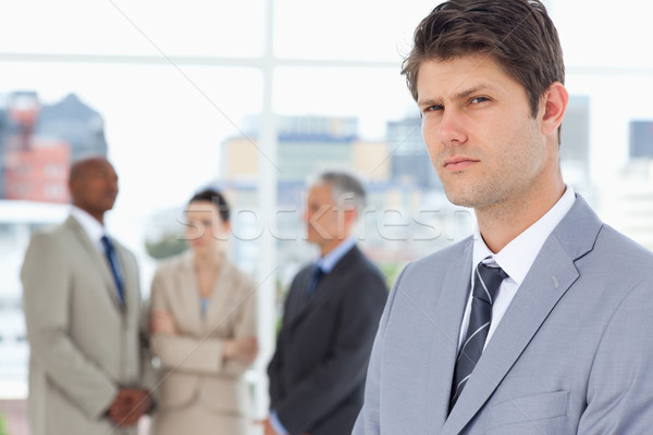 Young businessman with a stern look standing in front of executives Stock photo © wavebreak_media
