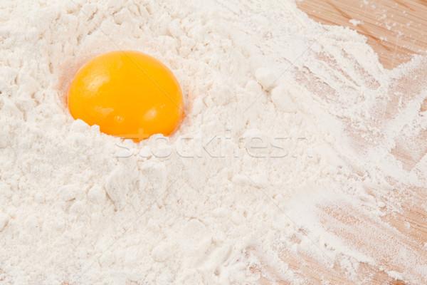 Egg yolk on the flour in a high angle view Stock photo © wavebreak_media