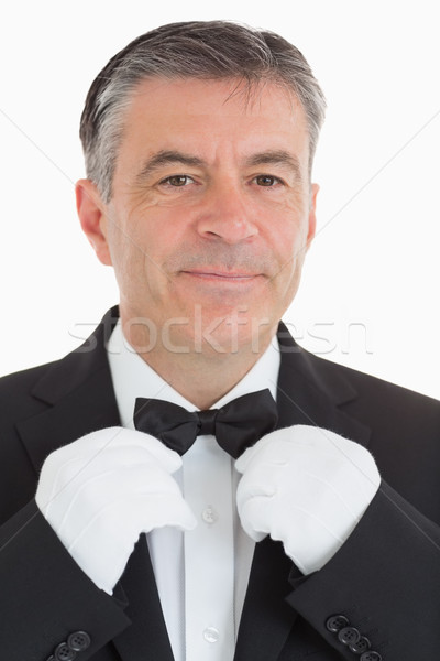 Cheerful and Well-dressed waiter is adjusting his bow tie Stock photo © wavebreak_media