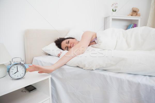 сонный женщину стороны будильник кровать дома Сток-фото © wavebreak_media