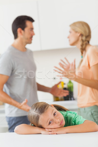 Couple arguing behind a sad girl  Stock photo © wavebreak_media