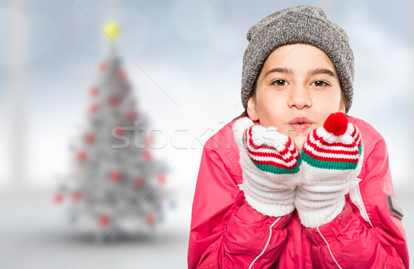 Composite image of wrapped up little girl blowing over hands Stock photo © wavebreak_media