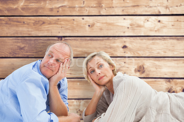 Composite image of mature couple lying and thinking Stock photo © wavebreak_media