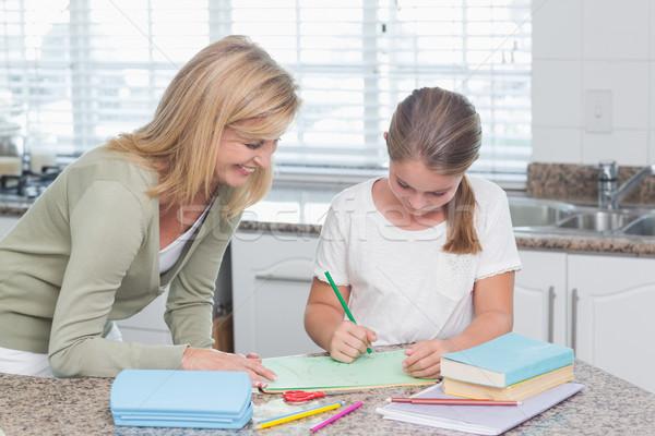 Mutlu anne yardım kız ödev ev Stok fotoğraf © wavebreak_media