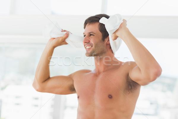 Smiling shirtless man with towel in gym Stock photo © wavebreak_media