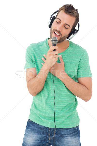 Giovane cantare microfono bianco musica Foto d'archivio © wavebreak_media