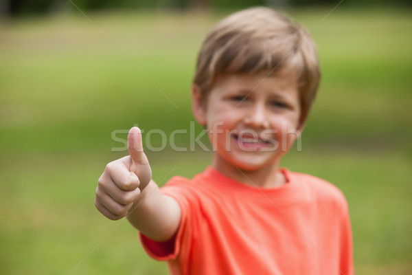 Smiling young boy gesturing thumbs up at park Stock photo © wavebreak_media