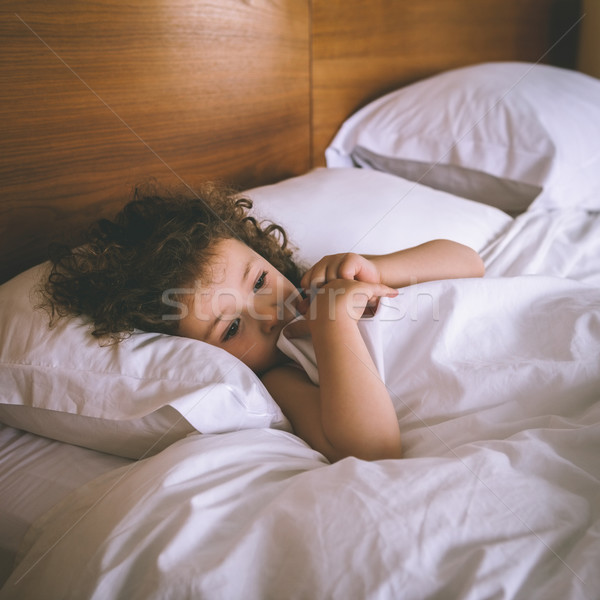 Stock photo: Close-up of a girl resting in bed