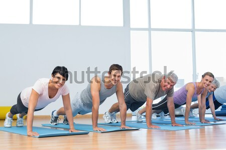 Grupy pompek rząd jogi klasy fitness Zdjęcia stock © wavebreak_media