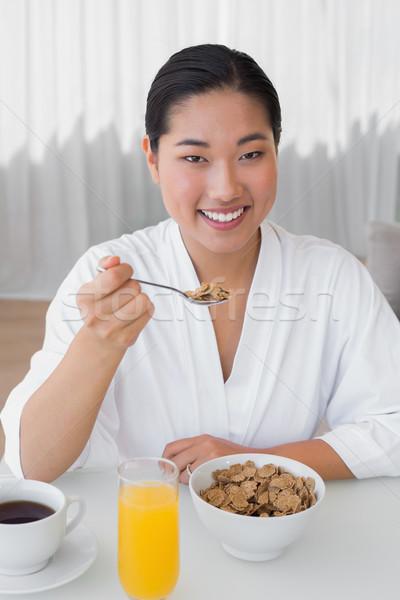 Gelukkig vrouw badjas ontbijt home woonkamer Stockfoto © wavebreak_media