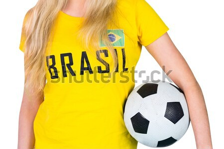 Fit girl in bikini and brasil tshirt holding ball Stock photo © wavebreak_media