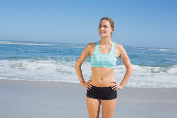 Uygun kadın ayakta plaj eller kalça Stok fotoğraf © wavebreak_media