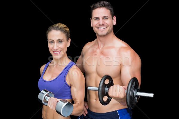 Crossfit pár pózol súlyzók mosolyog kamera Stock fotó © wavebreak_media