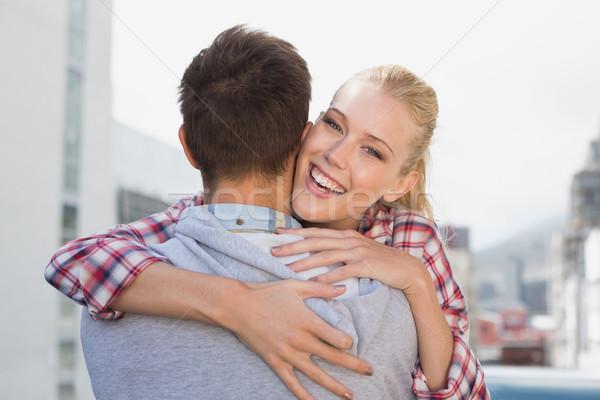 Biodro uśmiechnięta kobieta kamery Zdjęcia stock © wavebreak_media