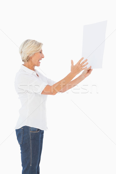 Angry woman shouting at piece of paper Stock photo © wavebreak_media