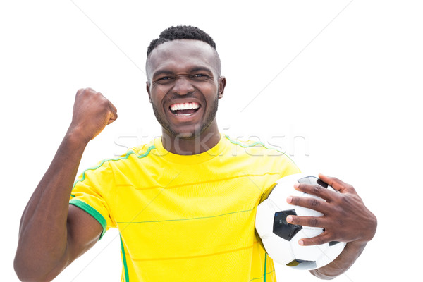 Football player in yellow celebrating a win Stock photo © wavebreak_media