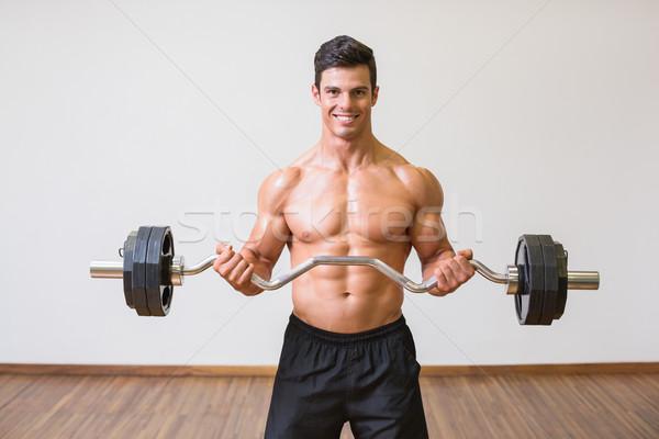 Póló nélkül izmos férfi emel súlyzó tornaterem Stock fotó © wavebreak_media