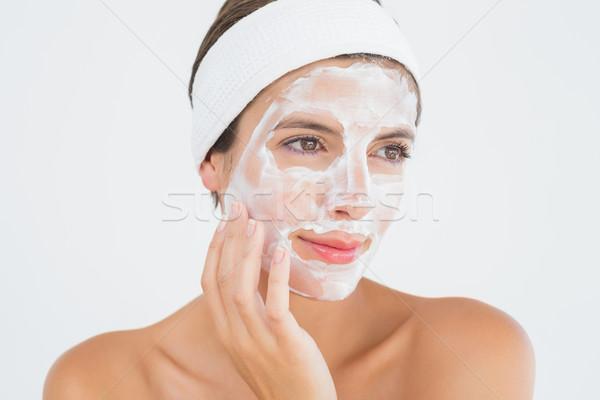 Mulher atraente branco creme cara estância termal Foto stock © wavebreak_media