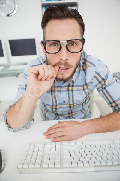 Intrigado empresário trabalhando computador escritório negócio Foto stock © wavebreak_media