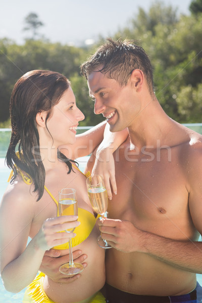 Coppia champagne flauti piscina sorridere romantica Foto d'archivio © wavebreak_media
