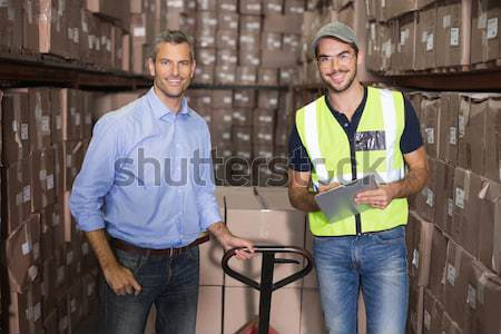 Warehouse manager talking with worker Stock photo © wavebreak_media