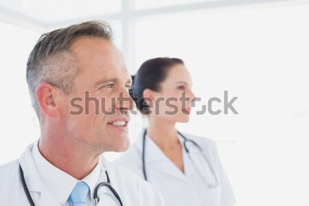 Doctor smiling while looking away Stock photo © wavebreak_media