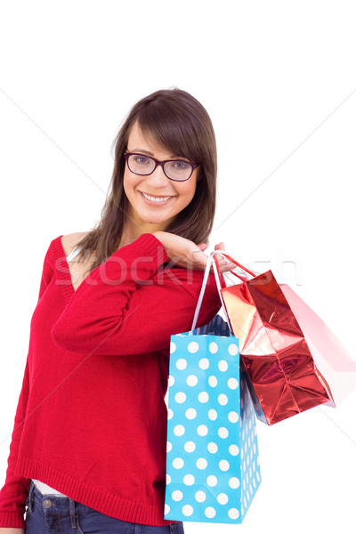 Mosolyog barna hajú tart bevásárlótáskák fehér portré Stock fotó © wavebreak_media