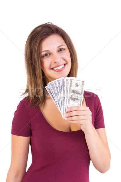 Pretty brunette showing wad of cash Stock photo © wavebreak_media